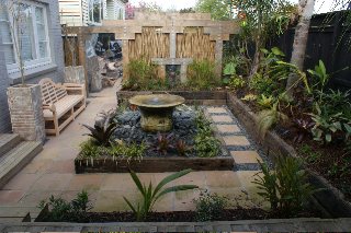 Landscaping auckland natural stone paving tim friday for Sticks and stones landscaping